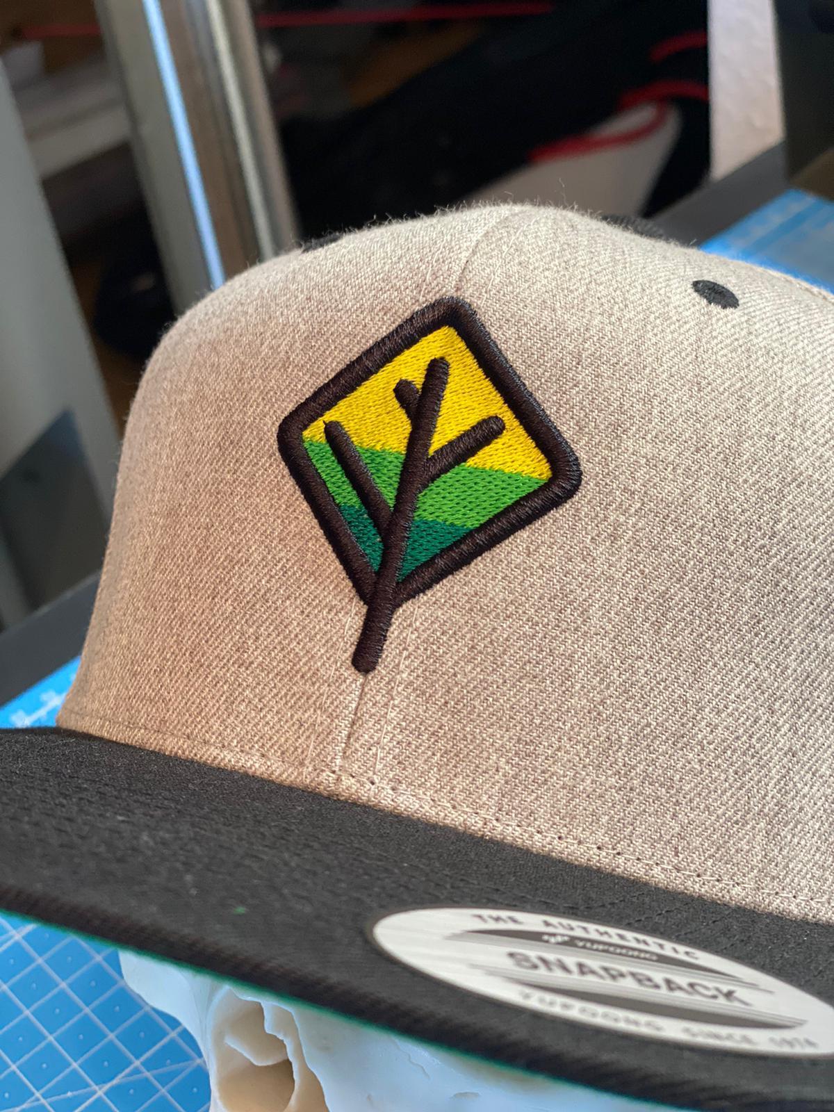 Save-A-Tree-Cap-Baumlogo